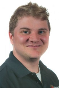 Tucker Copi's headshot photograph.